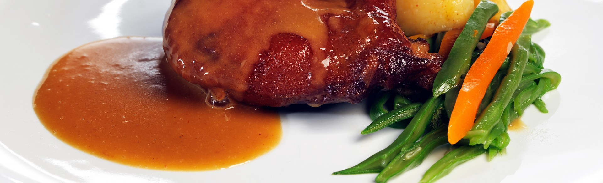 Duck confit with orange sauce